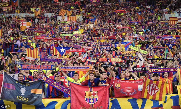 barcelona-fans-cheer-as-they-enter-the-stadium